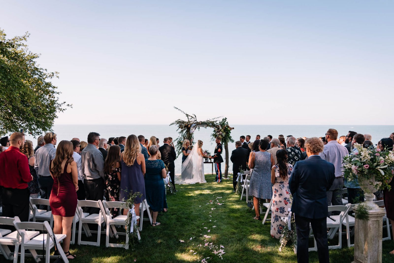 Outdoor Waterfront Wedding Ceremony with Flower Arch
