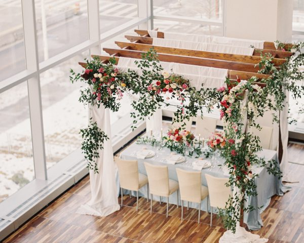 Flower draped arbor over dining table at Cleveland Hilton