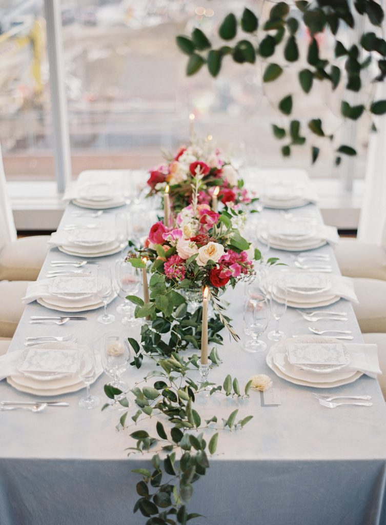 Light Blue Linens with Pink, Peach and White Flowers for Wedding Tables