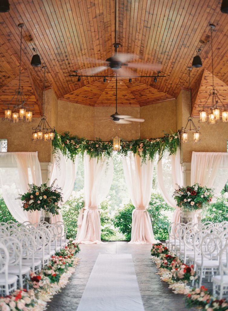High Ceiling Drapes and Flowers for Wedding Ceremony Backdrop