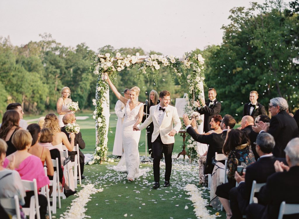 Bride and Groom Walk Down Rose Petal Aisle