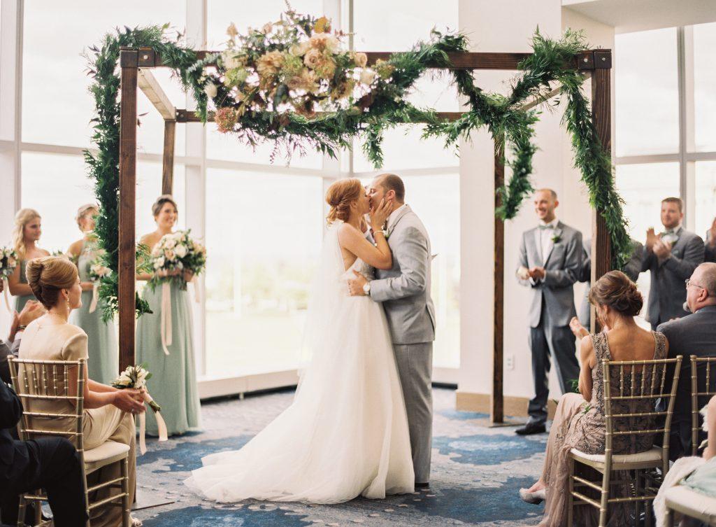 First Kiss Under Wedding Arch