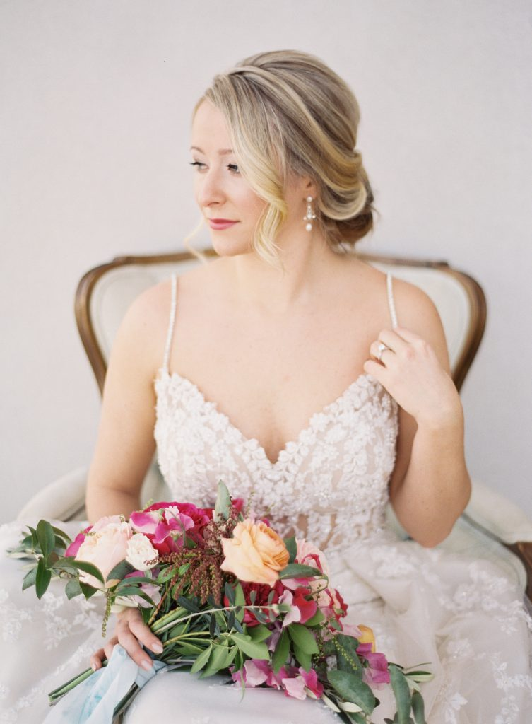 Bride Sitting in Chair with Bouquet