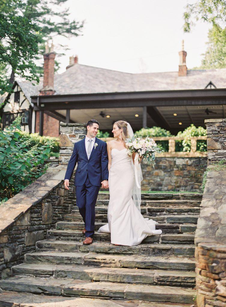 Bride and Groom walking down stone steps