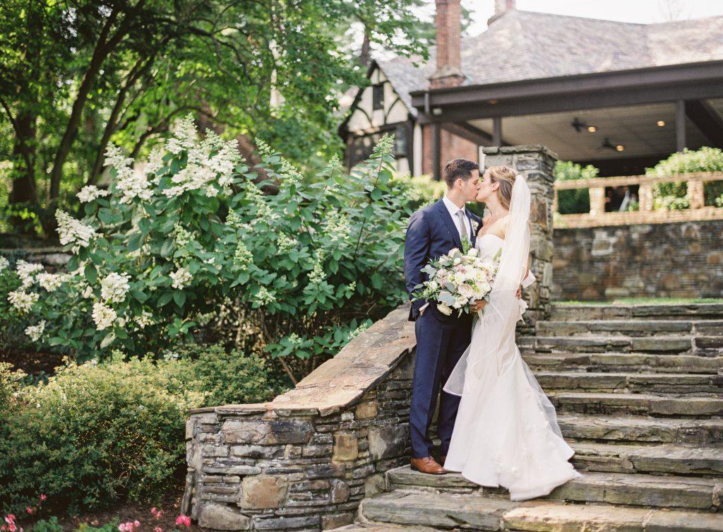 Groom kissing Bride on Stone Steps