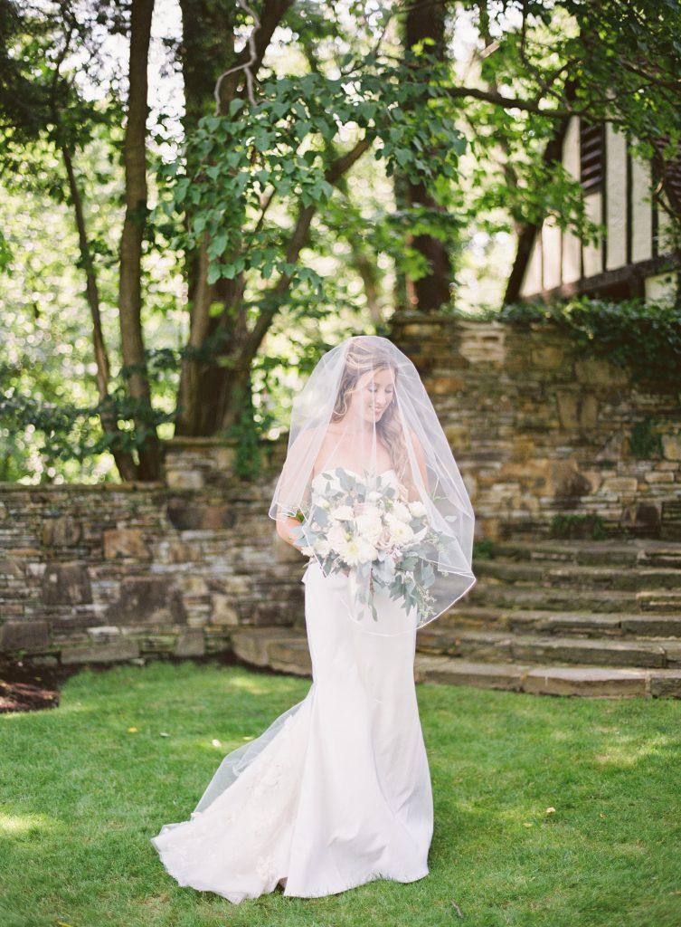 Bride walking in grass