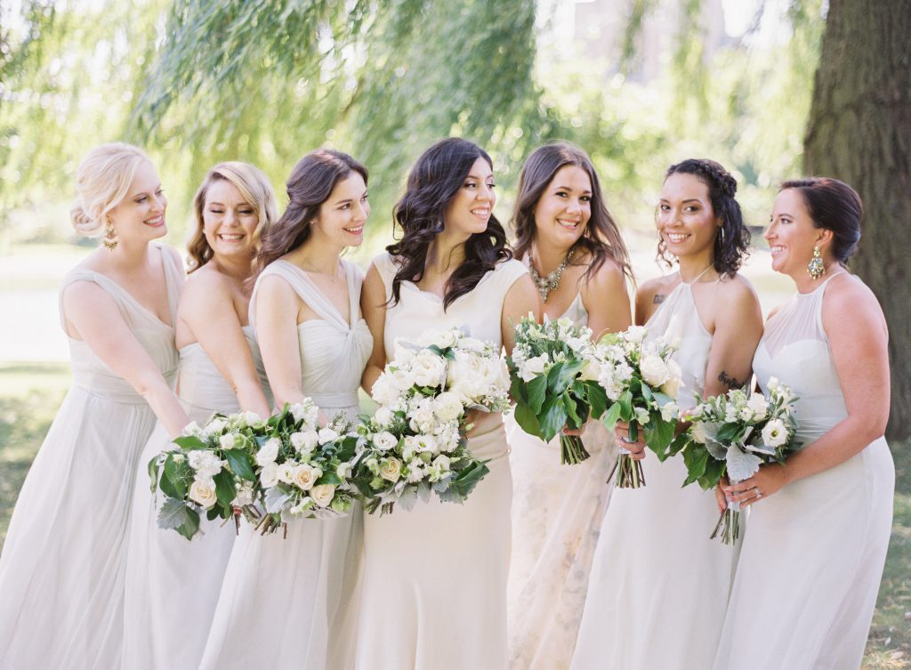 Bride with Bridesmaids with white flowers