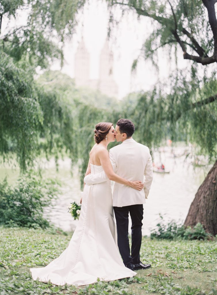 Bride and Groom kiss under Weeping Willow Trees