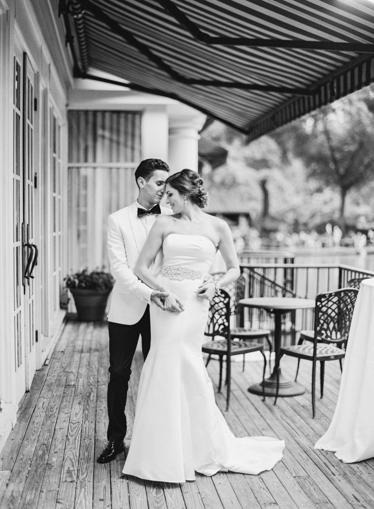 Black and white photo of groom holding bride