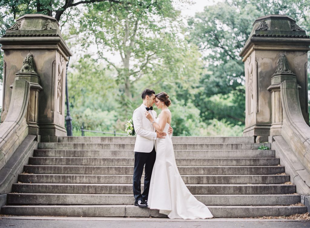 Bride and Groom embrace on stone steps