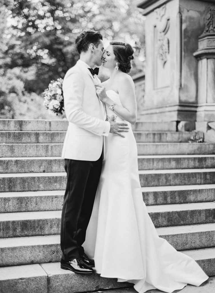 Black and white of bride and groom embracing