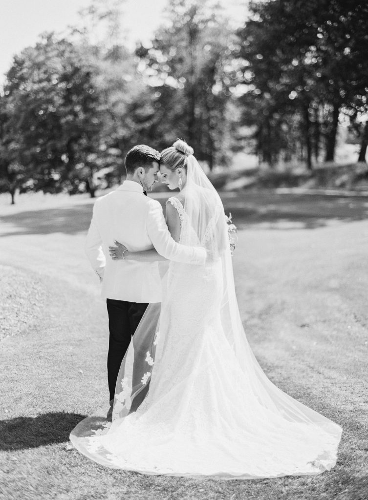 Black and white of Bride and Groom staring into each other's eyes