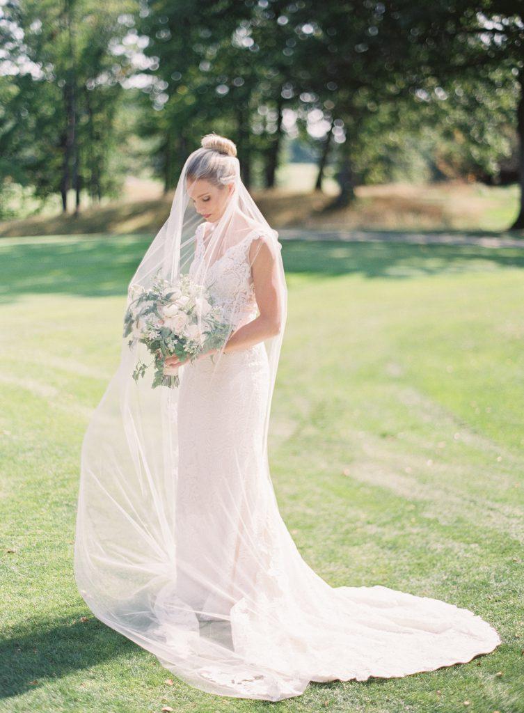 Bride with blonde hair in high ballerina bun