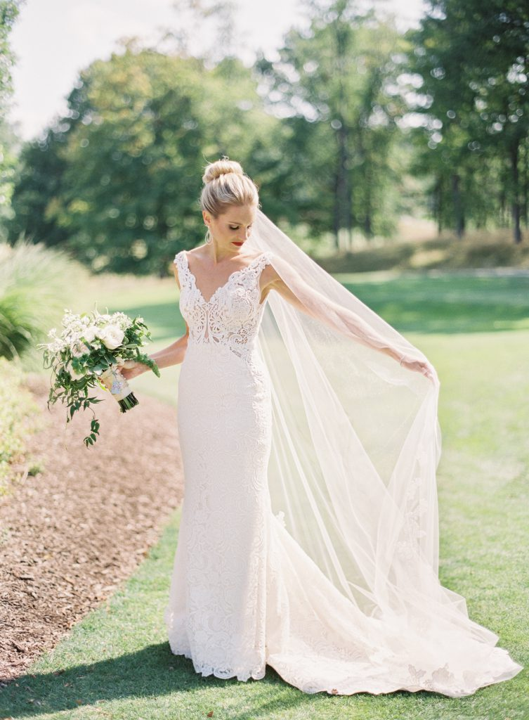 Bride holding her veil