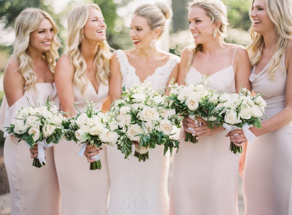 All blonde bridal party wearing blush dresses