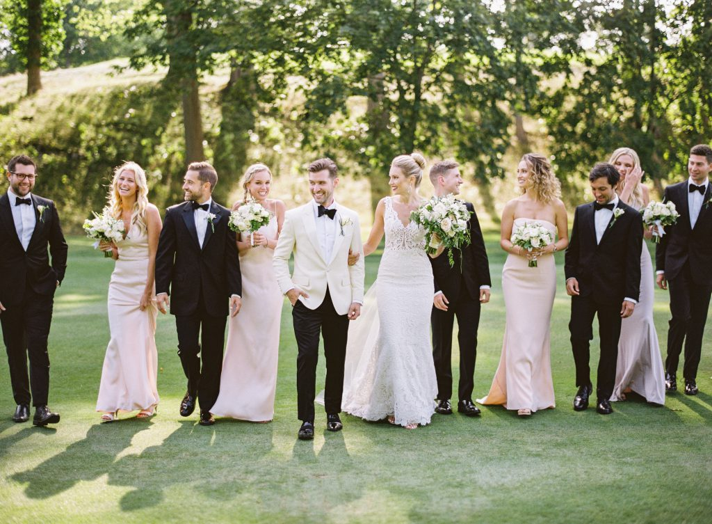 Black tie tuxedos and blush bridesmaids dresses