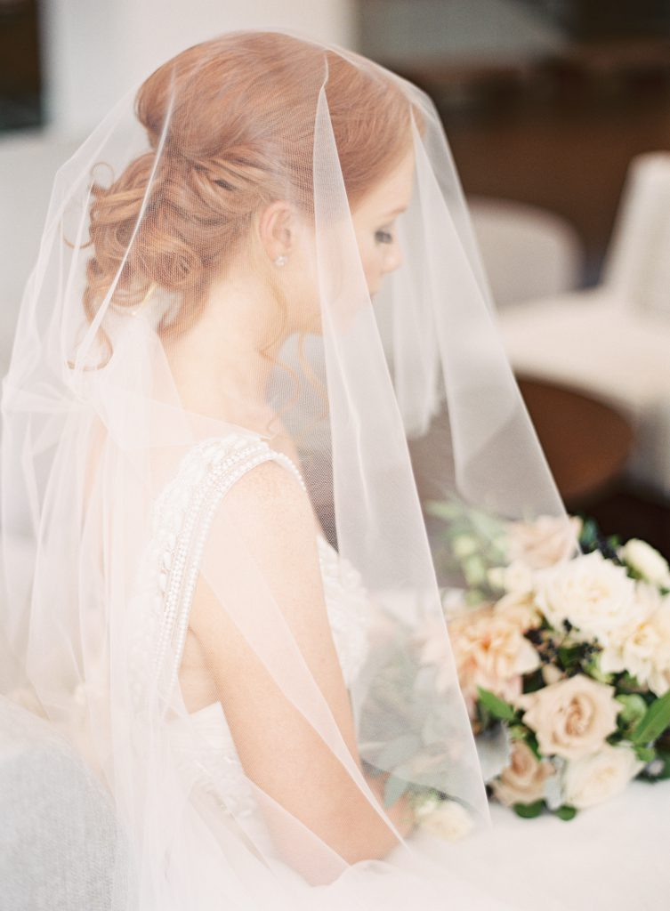 Red headed bride with veil