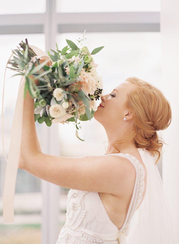 Bride smelling her bouquet