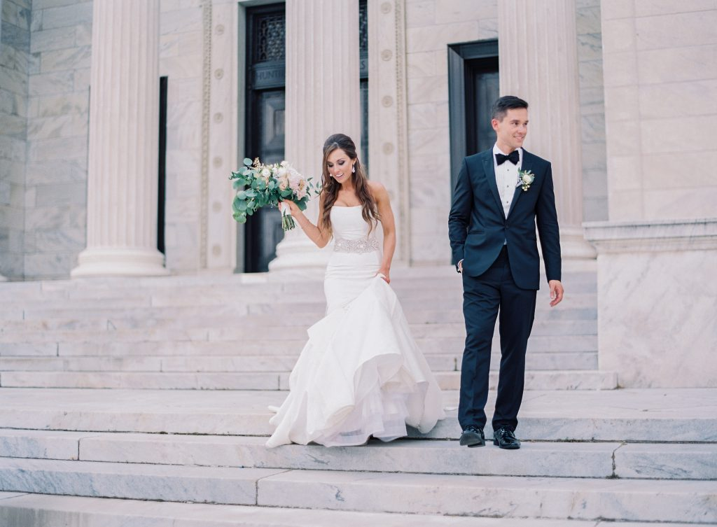 Groom and Bride walking down steps of Cleveland Museum of Art
