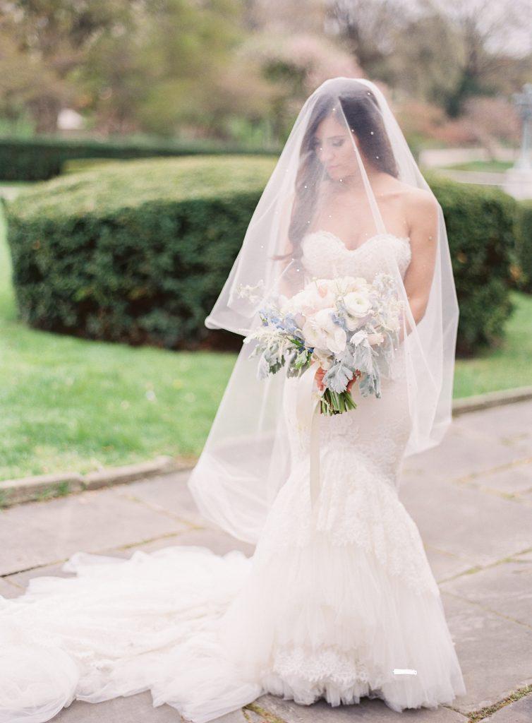 Dark haired bride with veil