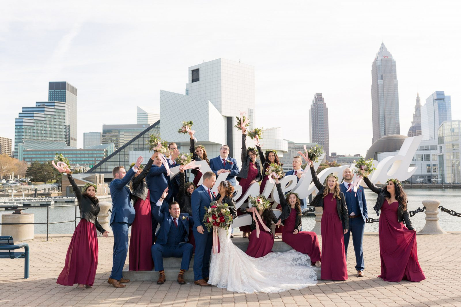 Bridal Party in leather jackets in front of Cleveland Sign