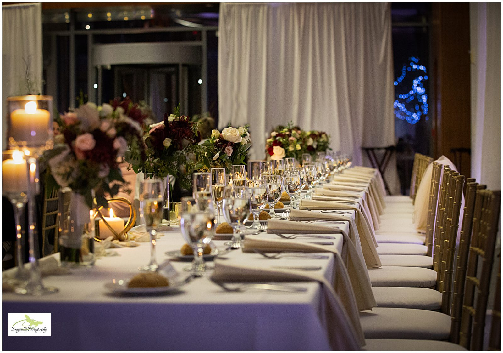 Candle-lit long dining table at Aloft Cleveland by Imagine It Photography