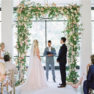 Cleveland Botanical Gardens indoor ceremony with floral arch