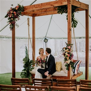 Bride and Groom on Swing by Borrow Curated