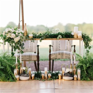 Greenery and Flower draped Sweetheart Table by Feather + Rock Events