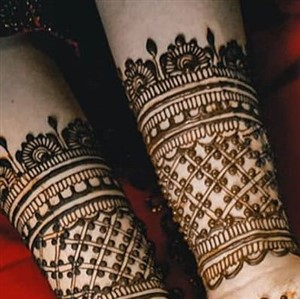 Closeup of arms with henna body art