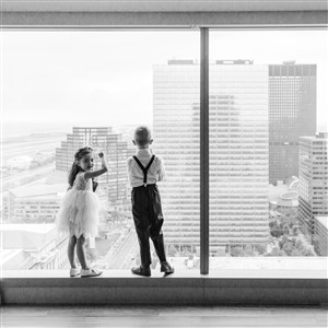 Boy and Girl looking out on city skyline before wedding