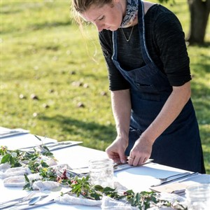 Woman Setting Table - Cleveland Field Kitchen