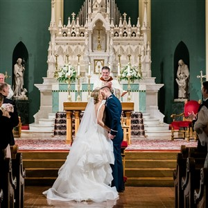 Bride and Groom Kiss at Alter in Church