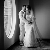 Bride and Groom portrait in front of full length round window at Music Box Supper Club Cleveland
