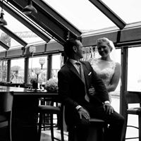 Bride and Groom portrait under glass roof at Music Box Supper Club Cleveland Wedding BW