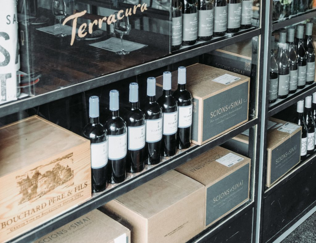 Wine Bottles and Cases on Shelf